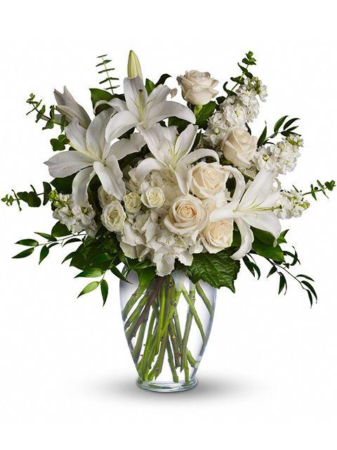 bouquet funerale di rose e gigli