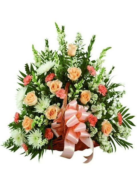 Cesto per funerale di fiori misti dai toni tenui