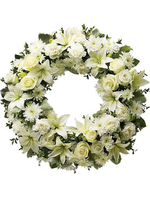 corona funerale di rose e gigli bianchi