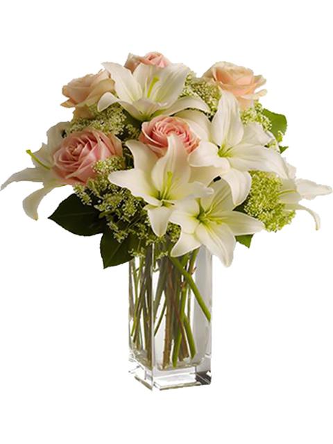 Bouquet di rose rosa e gigli bianchi per funerale